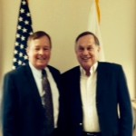 Lt. Gen. Dana T. Atkins (USAF, Retired), President & CEO of MOAA greets Dr. Cal Taylor (Lt.Col, USA, Retired), 2016 Vice President of Central Ohio Chapter, in MOAA Alexandria, Virginia offices on April 21, 2016. The two spoke about MOAA initiatives, membership, insurance, and protection of earned benefits.
